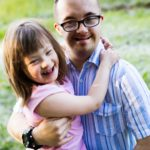 Picture of girl and man with down syndrome